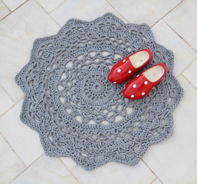 Crocheted doiley rug with wooden shoes