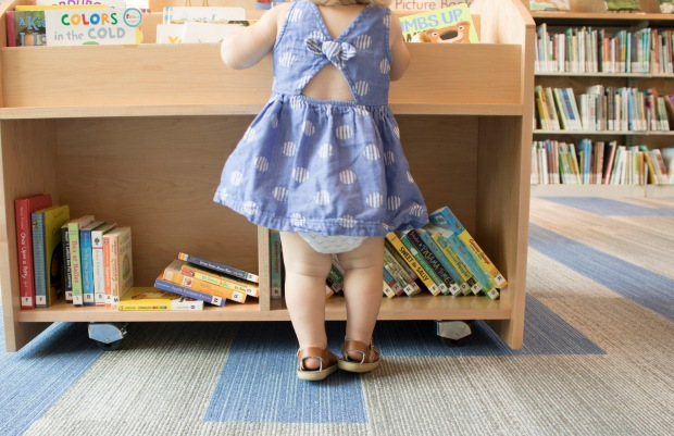 baby-looking-for-a-book-baby-legs